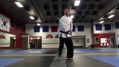 Man using a bo staff at a martial arts gym Live Action