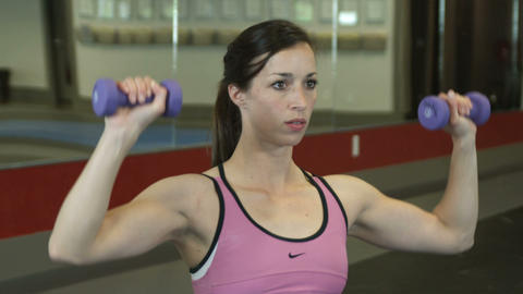 Close up shot of a female lifting weights Footage