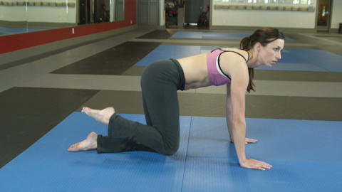 Female doing leg exercise on the floor Footage