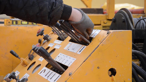 Hand of a worker operates a machine levers of command of deep sea drilling 07 Footage