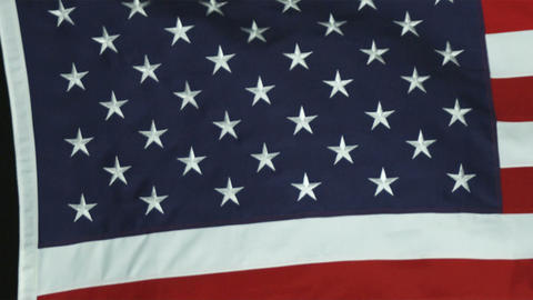 Panning close up of the American flag blowing in the wind Footage
