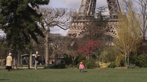Family playing ball near the Eiffel Tower Live Action