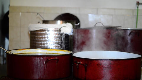 Pots of borsch simmering on the stove in the kitchen 03 Footage