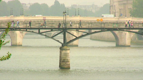 People walking across a bridge over the Seine in Paris Footage