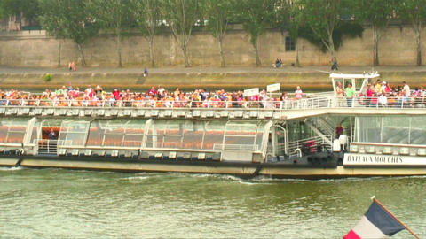 Two ferries on the Seine River in Paris, France Live Action
