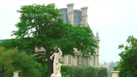 Statue in front of a large building in Paris Live Action