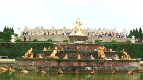 Shot of a fountain in a plaza in Versailles France Live Action