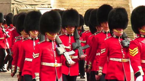 Procession of British soldiers in ceremonial uniforms Live Action
