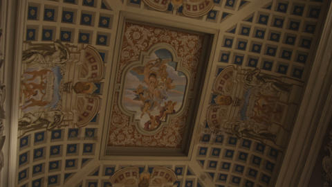 Looking up at a painted ceiling in Bologna Italy Footage