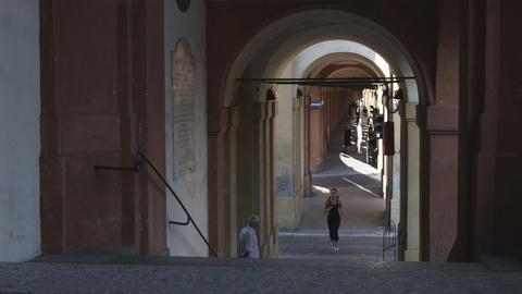 Woman jogging through an Italian city Footage