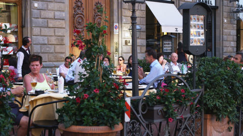 People eating outside a restaurant in Italy Footage