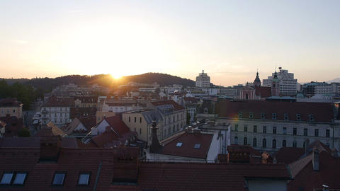 Aerial - Over the rooftop above the city at sunset Footage