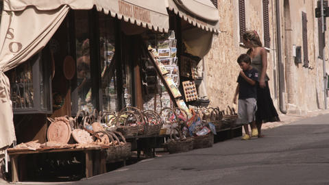 People shopping in a village in Tuscany Italy Footage