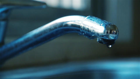 Closeup of Water Dripping from a Kitchen Faucet - Water Wasting Concept Footage