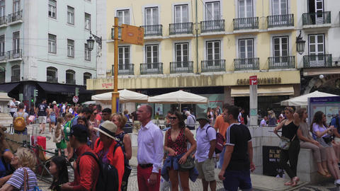 Lisbon, Portugal crowd waiting at historic tram 28 bus stop Live Action