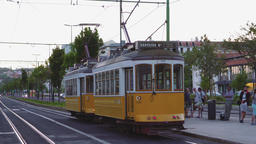 Lisbon, Portugal yellow electric trams at bus stop Footage