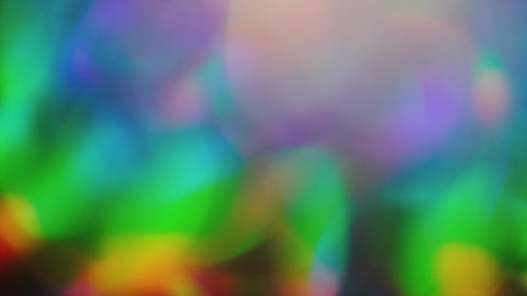 Glamorous iridescent background, blurred reflections from holographic foil Footage