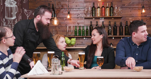 Bearded hipster waiter serves customers with beer Live Action
