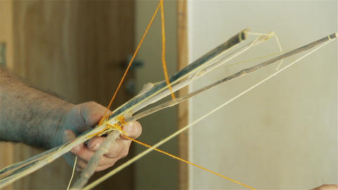 Man Building A Wooden Kite. Close-Up GIF