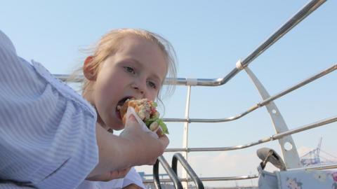 Little Girl Eating Hamburger GIF