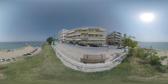360 VR Hotels on waterfront and people at the beach in Nea Kallikratia, Greece GIF