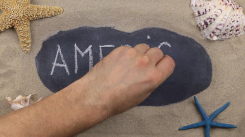 Handwritten word AMERICA written in chalk, among seashells and stars. Top view Footage