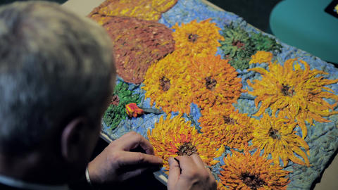 upper view man makes Van Gogh picture copy with play dough ビデオ
