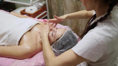 Spa woman facial Massage. Face Massage in beauty spa salon. Female enjoying Footage