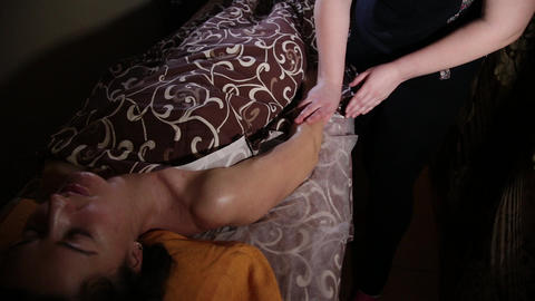 Very beautiful girl gets a massage on her hands in the... Stock Video Footage