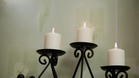 Candles in the candlestick in the spa salon GIF