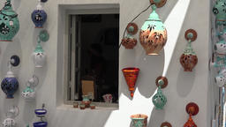 Greece Aegean Sea Cyclades Santorini Oia colorful ceramics at white house wall ビデオ