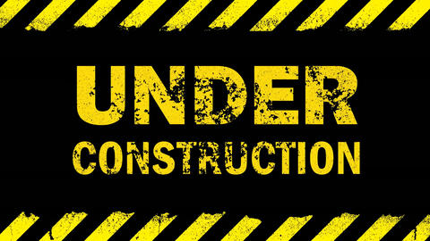 Yellow under construction sign on black background Animation