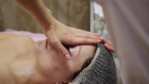 Spa woman facial Massage. Face Massage in beauty spa salon. Female enjoying Live Action