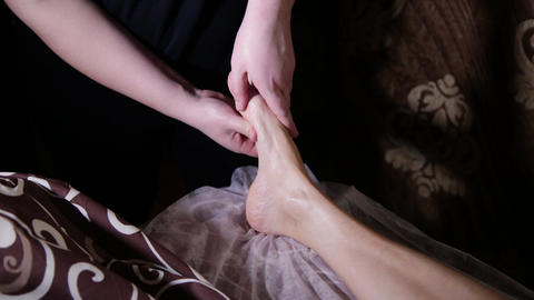 Very beautiful girl gets a foot massage in the spa salon Footage