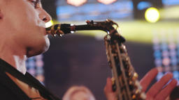 Musician playing alto saxophone on a gig, playing the saxophone GIF