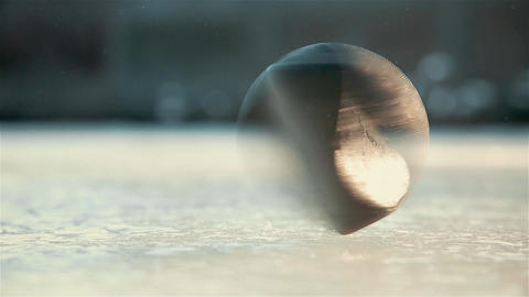 Quick spin of black hockey puck on ice rink HD 1020x1080 ビデオ
