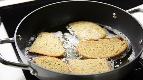 Frying bread in hot oil GIF