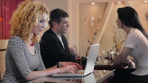 Woman Typing on a Laptop at a Café Stock Video Footage