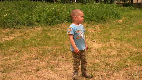 The little boy on the grass Stock Video Footage