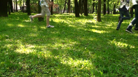Running on the grass, children Stock Video Footage