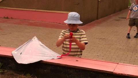 Boy poses a kite Stock Video Footage