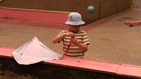 Boy poses a kite Stock Video Footage