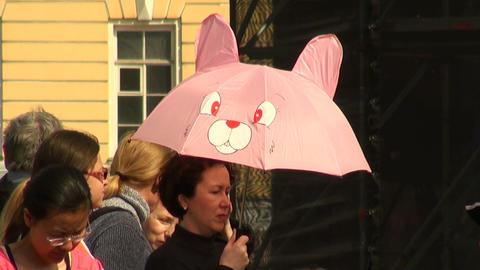 A woman under the umbrella funny Stock Video Footage