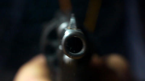 Revolver shoots edited Stock Video Footage
