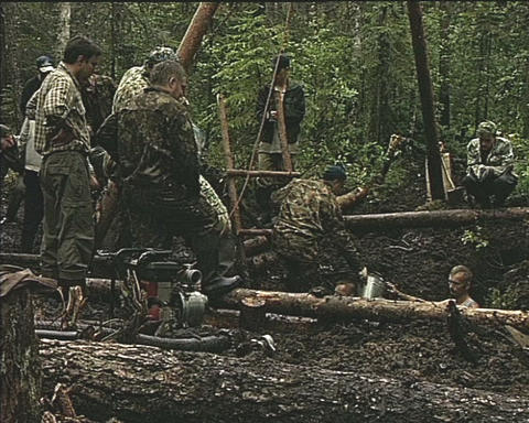 Searchers dig up the spoils of war Stock Video Footage