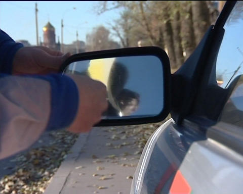 Cleaning the car mirror Stock Video Footage