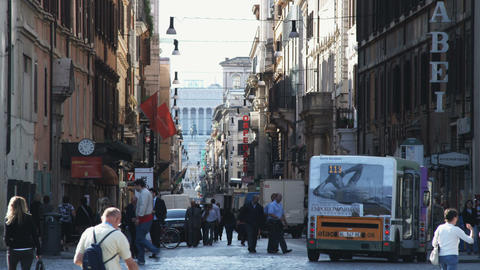 Alley between city buildings with a small crowd in Rome Footage