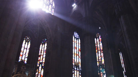 Shot of the sun coming through windows in a church in Milan Footage