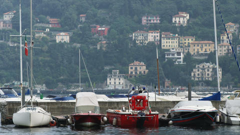 Boats tied to a dock on Lake Como in Italy Live Action