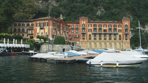Hotel on Lake Como near a docking area in Italy Live Action